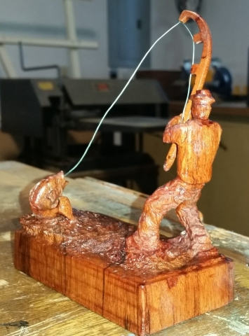 Carved Fisherman in Walnut